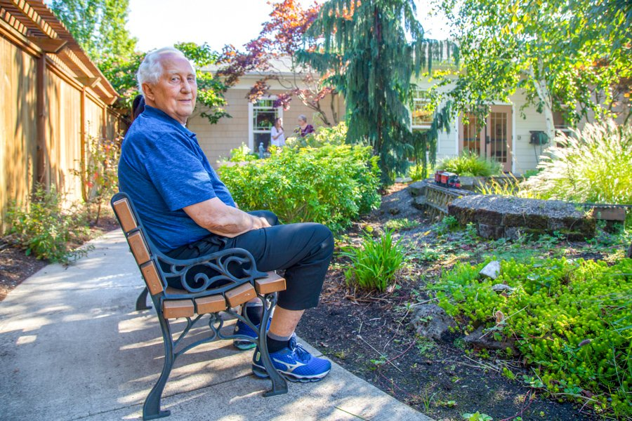 Man sitting in memory care at Hearthstone at Murrayhill