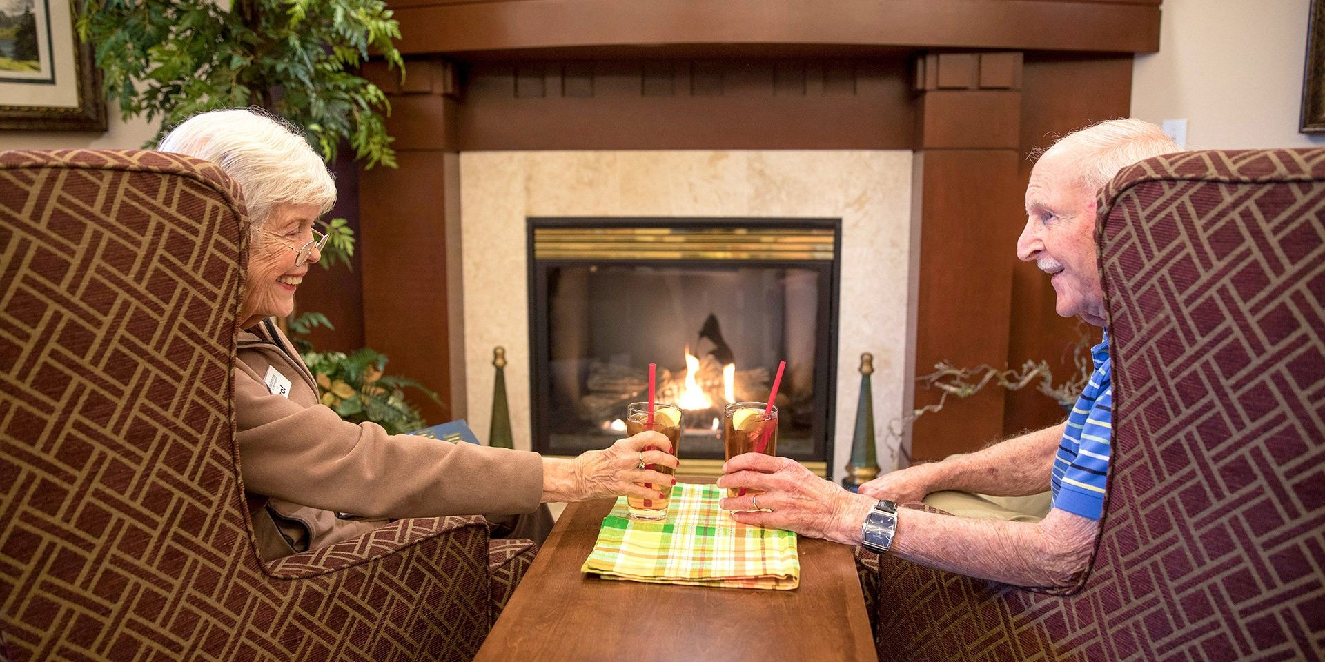 Hearthstone-Senior-Living_Couple_Fireplace-2